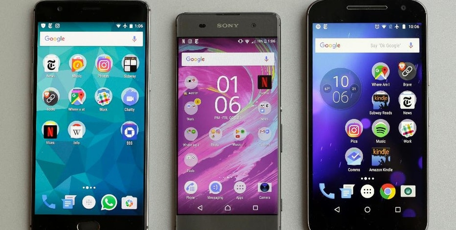 This Oct. 21, 2016, photo shows a Motorola MotoG4, right, a Sony Xperia XA, center, and a OnePlus A3000, in New York. You can save hundreds of dollars on an Android phone, especially if you don't need a top-end camera. Cheaper Android phones are, in many respects, adequate substitutes for pricier high-end models such as Samsung's Galaxy S7 and Google's Pixel. There are dozens worthy of consideration. (AP Photo/Richard Drew)