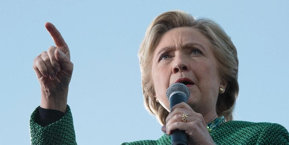 FILE - In this Oct. 23, 2016 file photo, Democratic presidential candidate Hillary Clinton speaks at a campaign event in Charlotte, N.C. Poring through tranches of private, stolen emails from Hillary Clinton's campaign is fast becoming a grinding daily ritual in Washington. As of Tuesday, Oct. 25, 2016, the WikiLeaks organization has published more than 31,000 emails from the accounts of John Podesta, chairman of Clinton's presidential campaign. (AP Photo/Mary Altaffer, File)