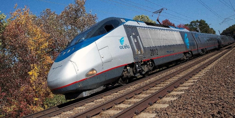 In this Tuesday, Oct. 18, 2016 photo, an Amtrak Acela train travels through Old Lyme, Conn. A plan to speed up Amtrak's high-speed rail corridor from Boston to Washington, D.C., is welcomed by business commuters but finding its strongest opposition in some shoreline towns in Connecticut. (AP Photo/Michael Dwyer)