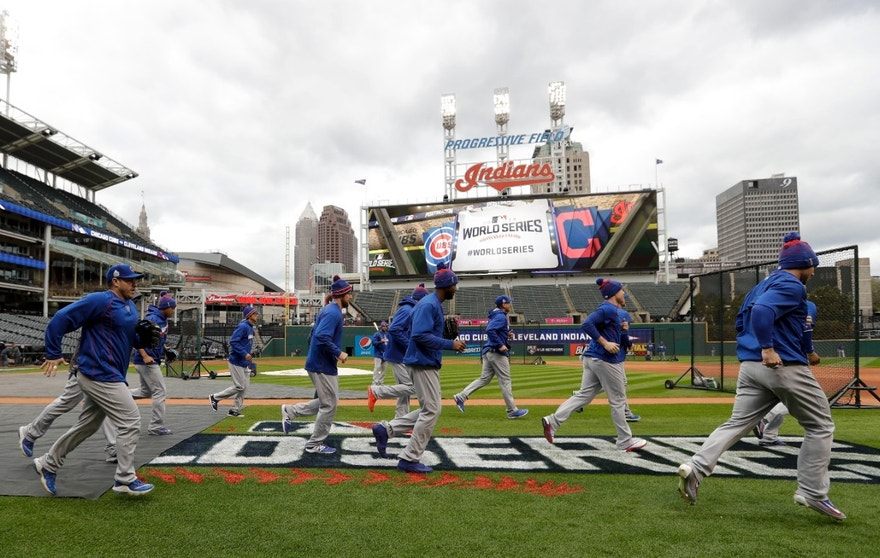 Members of the Chicago Cubs warm up during a team practice for baseball's upcoming World Series against the Cleveland Indians on Monday, Oct. 24, 2016 in Cleveland.