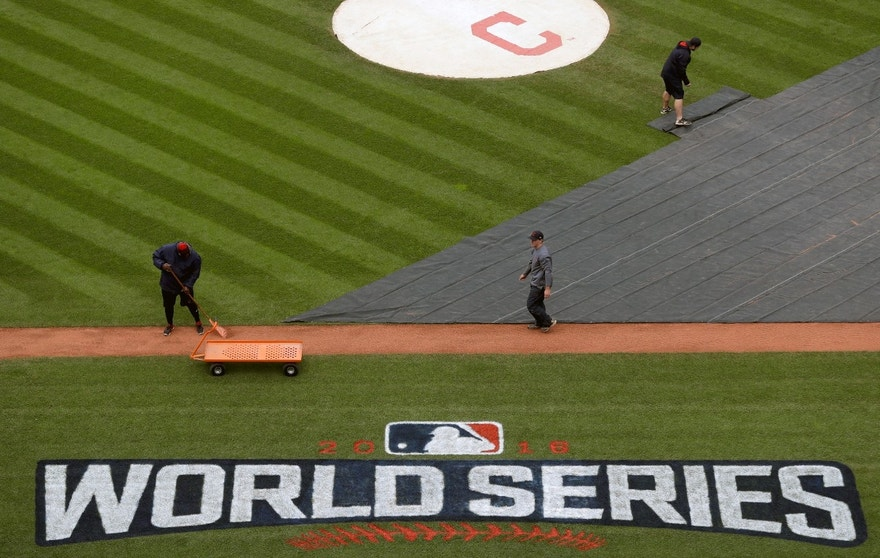 Members of the grounds crew prepare the field for batting practice for baseball's upcoming World Series between the Cleveland Indians and the Chicago Cubs, Monday, Oct. 24, 2016 in Cleveland.