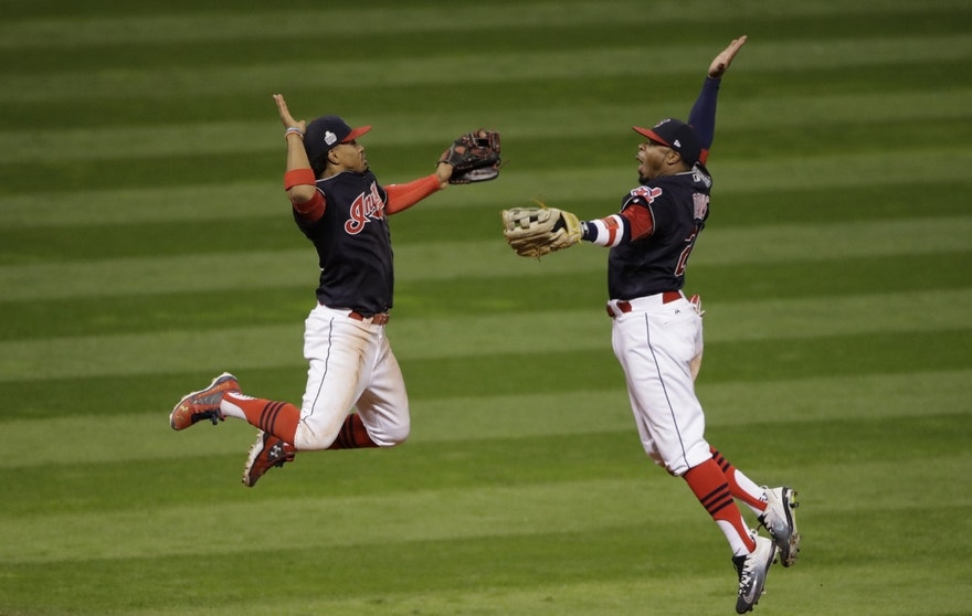 Cleveland Indians' Francisco Lindor and Rajai Davis celebrate after Game 1 of the Major League Baseball World Series against the Chicago Cubs Tuesday, Oct. 25, 2016, in Cleveland. The Indians won 6-0 to take a 1-0 lead in the series.