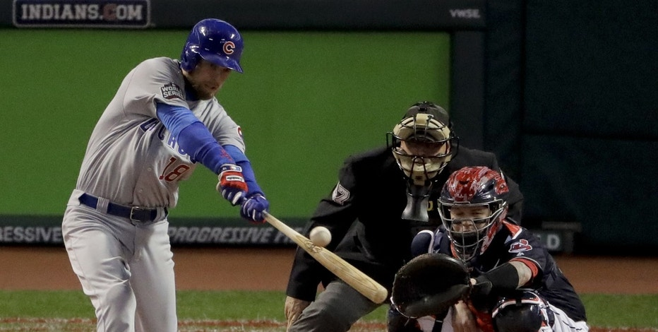 Chicago Cubs' Ben Zobrist hits a double against the Cleveland Indians during the second inning of Game 1 of the Major League Baseball World Series Tuesday, Oct. 25, 2016, in Cleveland.