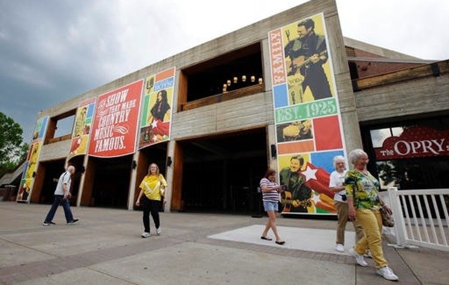 FILE - In this May 1, 2013, file photo, people visit the the Grand Ole Opry House in Nashville, Tenn. (AP Photo/Mark Humphrey, File)