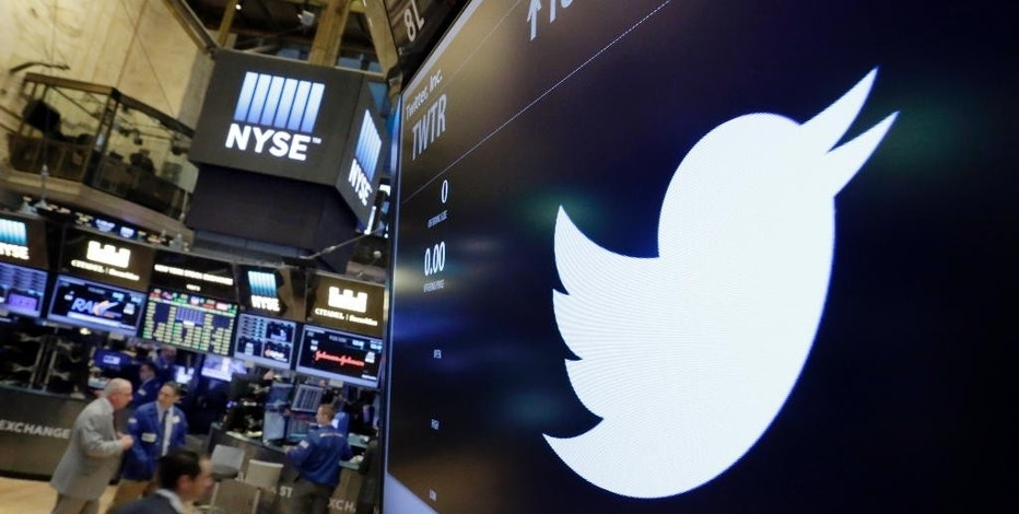 FILE - In this July 27, 2016, file photo, the Twitter symbol appears above a trading post on the floor of the New York Stock Exchange. Twitter, seemingly unable to find a buyer and losing money, is cutting about 9 percent of its employees worldwide. The company also announced third-quarter results Thursday, Oct. 27. (AP Photo/Richard Drew, File)