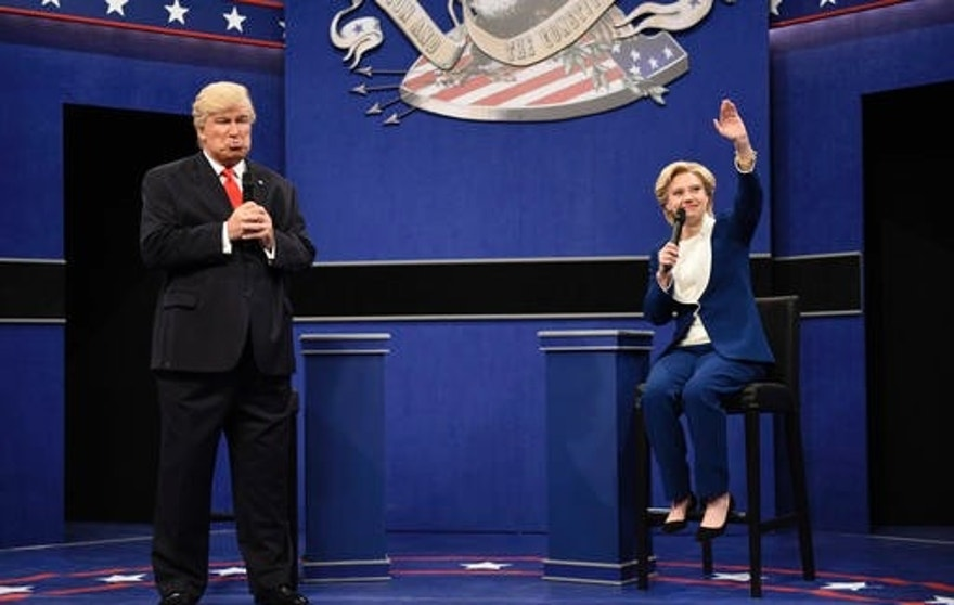 "In this Oct. 15, 2016 photo provided by NBC, Alec Baldwin, left, as Republican presidential candidate, Donald Trump, and Kate McKinnon, as Democratic presidential candidate, Hillary Clinton, perform during the during the ""Debate Cold Open"" sketch. Republican presidential candidate Donald Trump tweeted early Sunday morning, Oct. 16 that the show's skit depicting him this week was a ""hit job."" Trump went on to write that it's ""time to retire"" the show, calling it ""boring and unfunny"" and adding that Alec Baldwin's portrayal of him ""stinks.""(Will Heath/NBC via AP)"