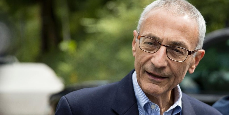 FILE - In this Oct. 5, 2016 file photo, Hillary Clinton's campaign manager John Podesta speaks to members of the media outside Clinton's home in Washington. New evidence appears to show how hackers earlier this year stole more than 50,000 emails of Hillary Clinton's campaign chairman, an audacious electronic attack blamed on Russia's government and one has resulted in embarrassing political disclosures about Democrats in the final weeks before the U.S. presidential election. (AP Photo/Andrew Harnik, File)