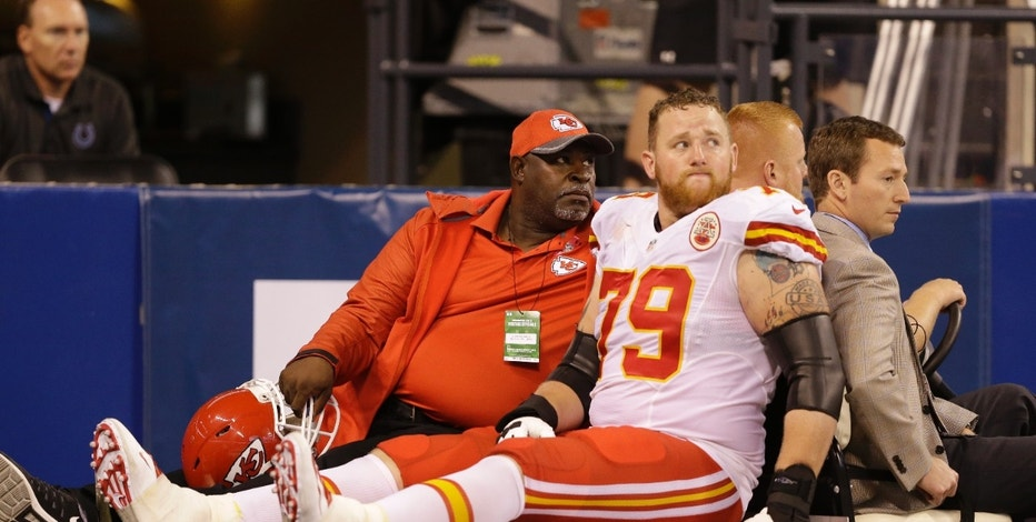 FILE - In this Oct. 30, 2016, file photo, Kansas City Chiefs' Parker Ehinger (79) is carted off the field during the second half of an NFL football game against the Indianapolis Colts, in Indianapolis. One day after four players left the game — including two Indianapolis Colts' players — with concussions, coach Chuck Pagano tried to tamp down the notion that it had something to do with the field conditions. Instead, he thought it was just an aberration.  (AP Photo/Michael Conroy, File)
