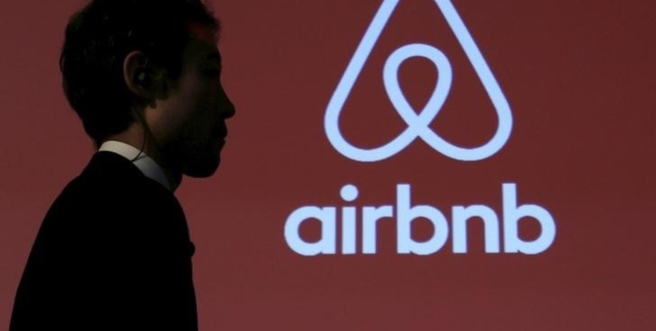 A man walks past a logo of Airbnb after a news conference in Tokyo, Japan, November 26, 2015. REUTERS/Yuya Shino/File Photo