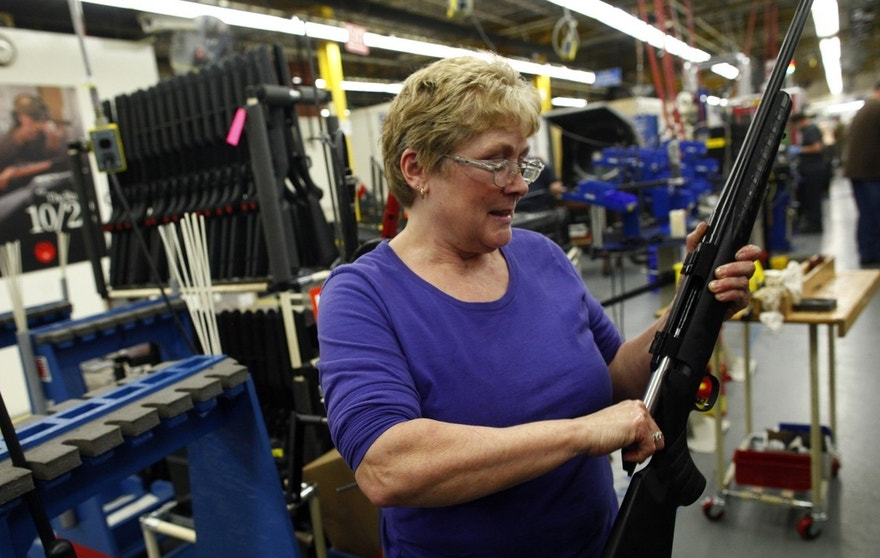 Worker Marilyn MacKay assembles a rifle at the Sturm, Ruger & Co., Inc. gun factory in Newport, New Hampshire January 6, 2012.