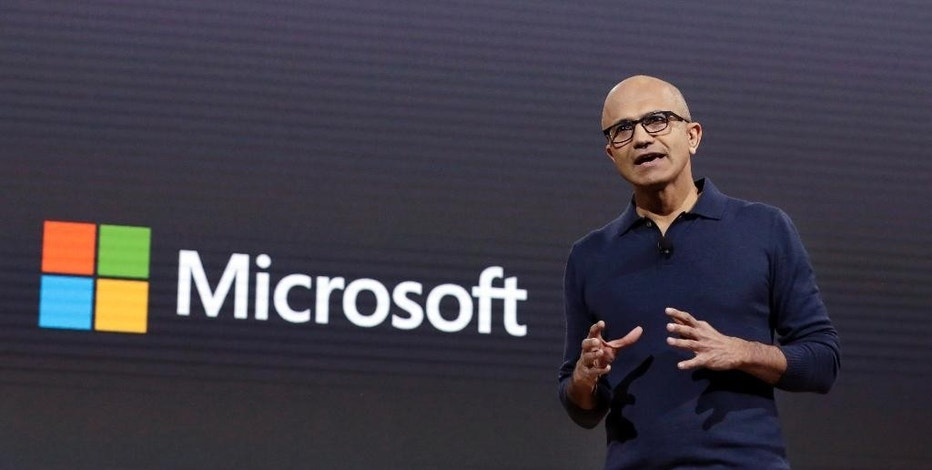 "FILE - In this Oct. 26, 2016 file photo, Microsoft CEO Satya Nadella addresses a Microsoft media event in New York.  Taking a cue from competing online services like Slack, which let workers chat and share information on the job, Microsoft is adding a new program called ""Teams"" to its Office 365 suite of internet productivity software. Analysts say Microsoft is catching up to a trend in which workers increasingly look beyond email and simple document-sharing services to communicate and collaborate. (AP Photo/Richard Drew)"
