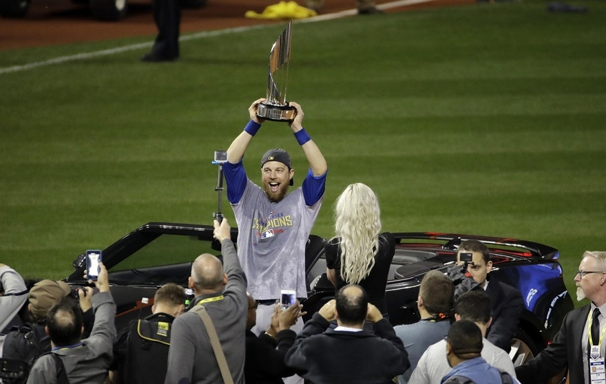 Chicago Cubs' Ben Zobrist celebrates with his MVP trophy after Game 7 of the Major League Baseball World Series against the Cleveland Indians Thursday, Nov. 3, 2016, in Cleveland. The Cubs won 8-7 in 10 innings to win the series 4-3.