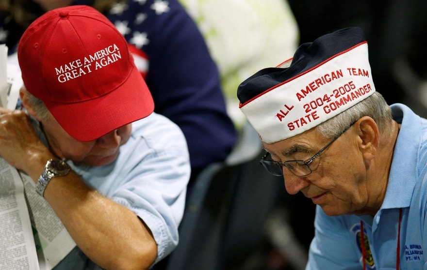 Members of the Veterans of Foreign Wars speak as they wait for U.S. Republican presidential nominee Donald Trump to speak at the Veterans of Foreign Wars Convention in Charlotte, North Carolina, U.S. July 26, 2016.