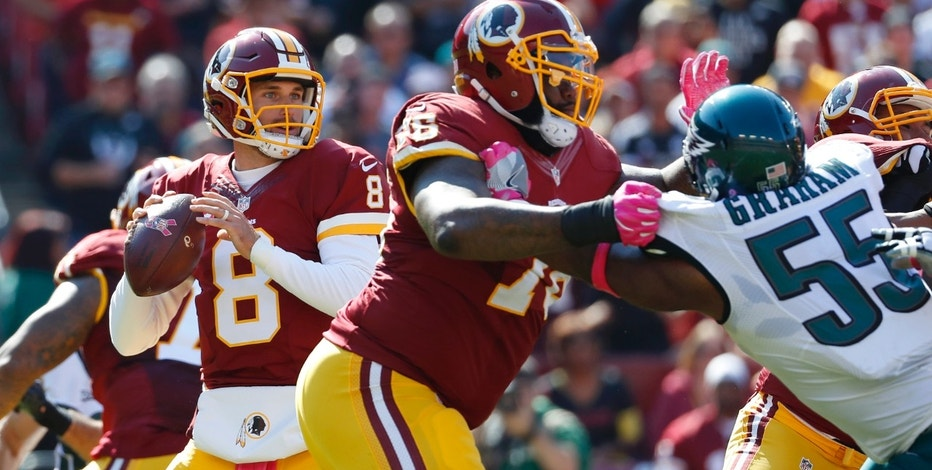 Washington Redskins quarterback Kirk Cousins (8) looks for a receiver as he is pressured in the first half of an NFL football game against the Philadelphia Eagles, Sunday, Oct. 16, 2016, in Landover, Md. (AP Photo/Alex Brandon)