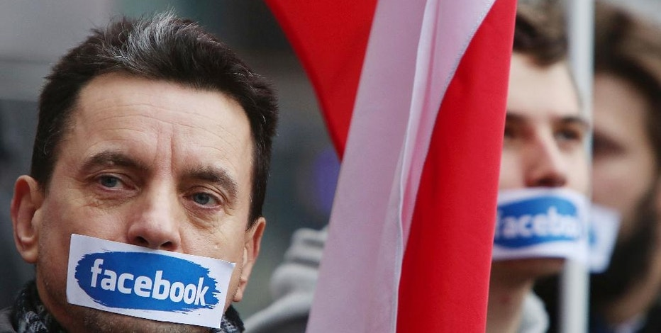 Supporters of Right Wing Movement protest against events, groups and profiles blocked by Facebook in front of the Facebook Office in Warsaw, Poland, Saturday, Nov. 5, 2016. Facebook recently blocked the profiles of far-right nationalist groups ahead of nationalist demonstrations on Independence Day next Friday, Nov. 11, when extremist groups often clash with police. (AP Photo/Czarek Sokolowski)