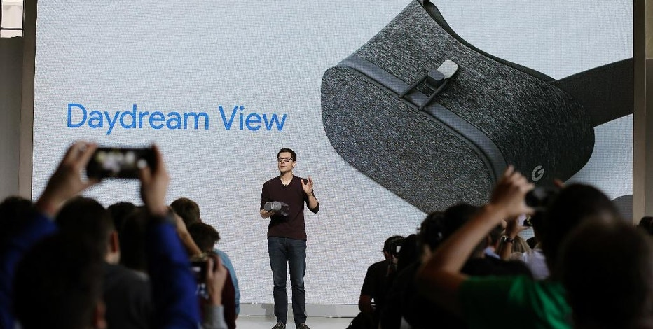FILE - In this Tuesday, Oct. 4, 2016, file photo, Clay Bavor, Google vice president of virtual reality, talks about the Daydream View virtual-reality headset during a product event, in San Francisco. Google's Daydream View virtual-reality headset sets itself apart by including a handheld controller that responds to gestures and other movement. It's a fine device for its price, but it still needs more apps to make its potential more than a dream. (AP Photo/Eric Risberg, File)