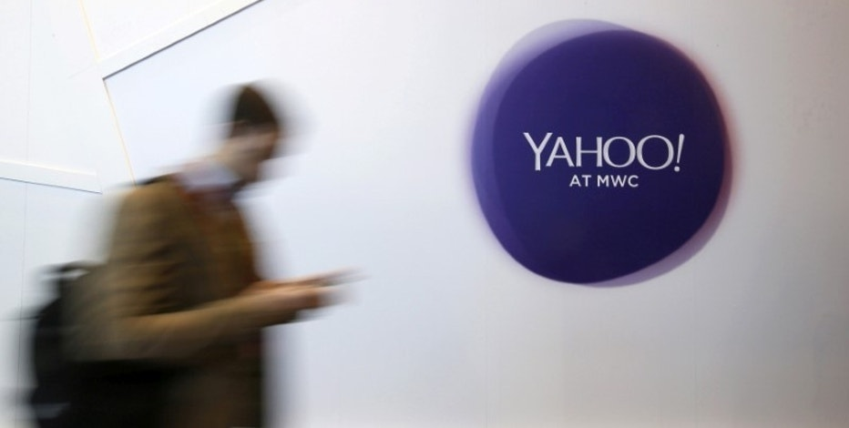 A man walks past a Yahoo logo during the Mobile World Congress in Barcelona, Spain, February 24, 2016. REUTERS/Albert Gea/File Photo