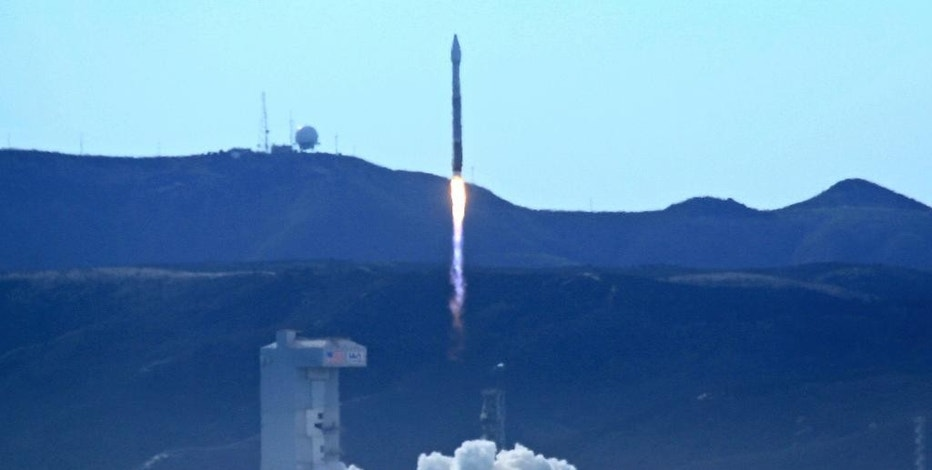 An Atlas 5 rocket carrying the WorldView-4 satellite is launched at the Vandenberg Air Force Base, Calif., on Friday, Nov. 11, 2016. The satellite is designed to produce high-resolution images of Earth from space. (Matt Hartman via AP)