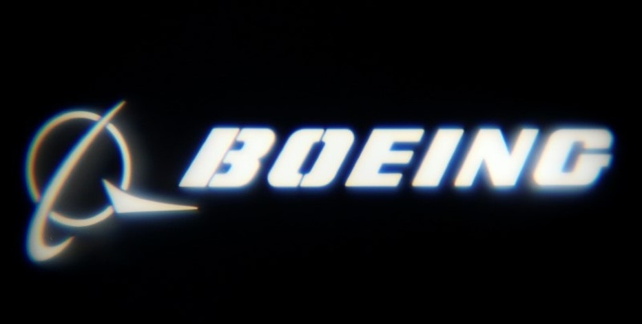 "The Boeing Company logo is projected on a wall at the ""What's Next?"" conference in Chicago, Illinois, U.S., October 4, 2016.    REUTERS/Jim Young"