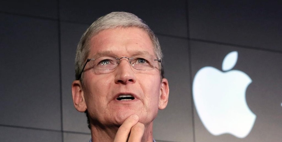 "FILE - In this April 30, 2015, file photo, Apple CEO Tim Cook responds to a question during a news conference at IBM Watson headquarters, in New York. CEOs of major companies are taking stands about the results of the November 2016 U.S. election, a departure from the traditional model of not mixing politics with business that the major brands have long espoused. Cook is telling his employees to ""keep moving forward."" (AP Photo/Richard Drew, File)"