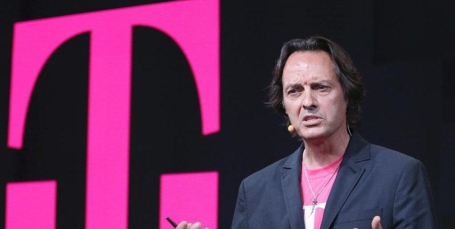 "FILE - In this Wednesday, July 10, 2013, file photo, T-Mobile CEO John Legere speaks during a news conference, in New York. CEOs of major companies are taking stands about the results of the November 2016 U.S. election, a departure from the traditional model of not mixing politics with business that the major brands have long espoused. Legere tweeted ""let's see what an out of the box, non-typical, non-politician can do for America!"" (AP Photo/Mary Altaffer, File)"