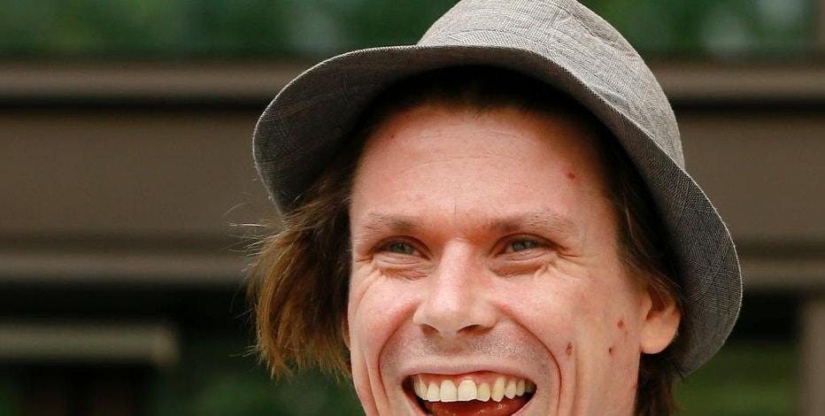 FILE- In this Monday, July 25, 2016 file photo, Lauri Love arrives at Westminster Magistrates court in London.  Britain has approved the extradition of an alleged computer hacker who is accused of snatching data from the U.S. Defense Department, the U.S. Army and the FBI. Love faces 99 years in prison if found guilty on cyber-hacking charges for allegedly compromising networks between October 2012 and October 2013 and stealing data. He has 14 days to appeal the decision.(AP Photo/Kirsty Wigglesworth, File)