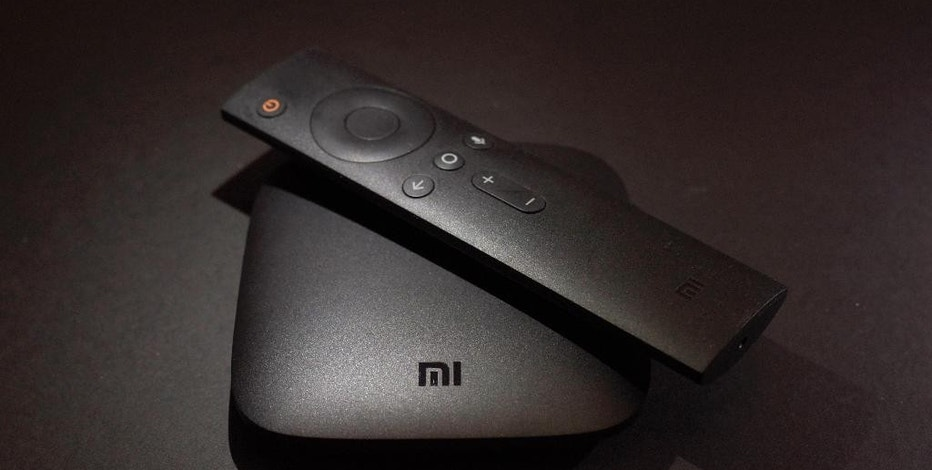 This Wednesday, Nov. 16, 2016 photo shows the Xiaomi's Mi Box streaming TV device in New York.  Your streaming TV options just got better and cheaper. Features that once required a $100 device can now be had for as little as $30. A cheap device is fine for getting TV shows and movies from most popular services onto a big-screen TV, as long as it's a regular, high-definition set. (AP Photo)
