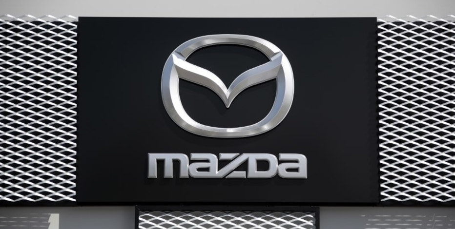 A Mazda car company logo is seen outside an automobile dealership in Nice, France, March 29, 2016.    REUTERS/Eric Gaillard