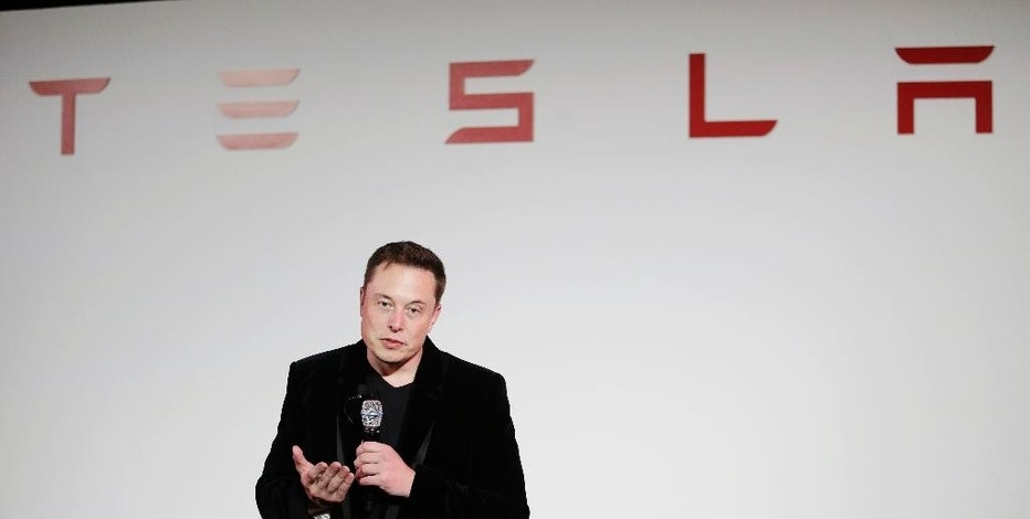 FILE - In a Sept. 29, 2015, file photo, Elon Musk, CEO of Tesla Motors Inc., talks about the Model X car at the company's headquarters, in Fremont, Calif. Musk will learn Thursday, Nov. 17, 2016, if shareholders support his plan to merge with SolarCity Corp. after a lengthy debate over the merits of the deal. Shareholders of both companies are scheduled to vote Thursday afternoon at two separate meetings near the companies' California headquarters. (AP Photo/Marcio Jose Sanchez, File)