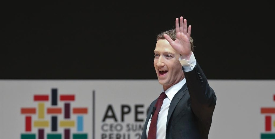 Mark Zuckerberg, chairman and CEO of Facebook, waves during a speech at the CEO summit during the annual Asia Pacific Economic Cooperation (APEC) forum in Lima, Peru, Saturday, Nov. 19, 2016. (AP Photo/Esteban Felix)