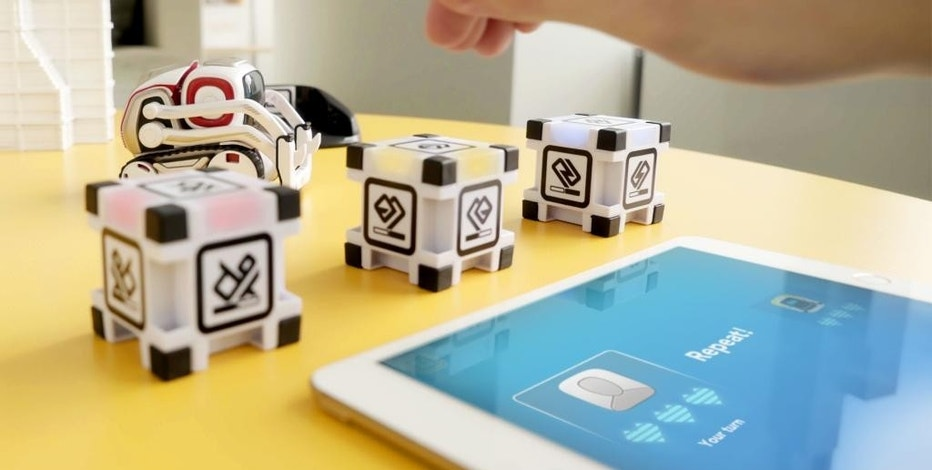 This photo provided by Anki shows the Cozmo Memory Match game. Whether you're looking for something educational or a toy that's just for fun, there are a lot of choices for the holidays. New toys include little robot friends full of personality and magnetic blocks that snap together to teach the basics of computer programming. (Anki via AP)