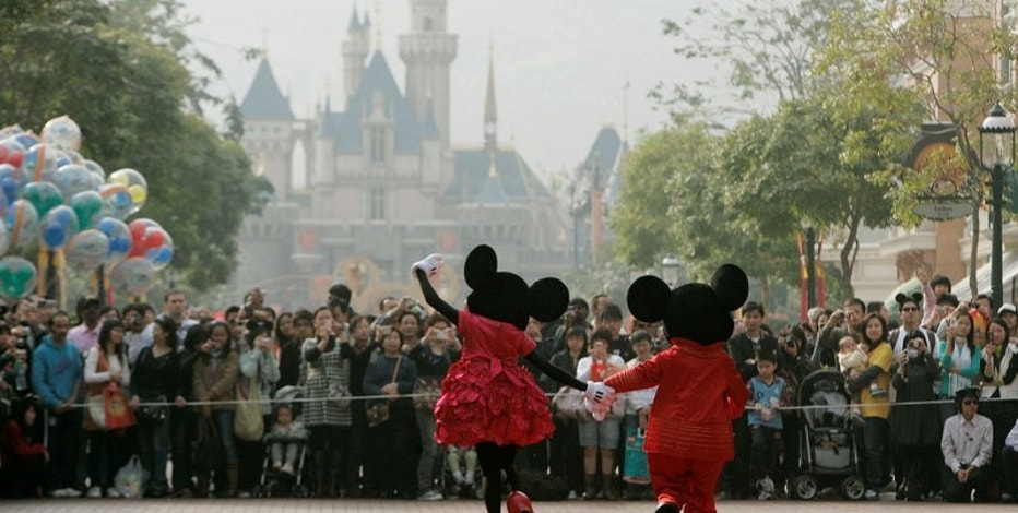 Mickey Mouse and Minnie Mouse characters greet visitors with their latest Year of the Mouse costumes at Hong Kong Disneyland, China in January 21, 2008. REUTERS/Bobby Yip/File Photo