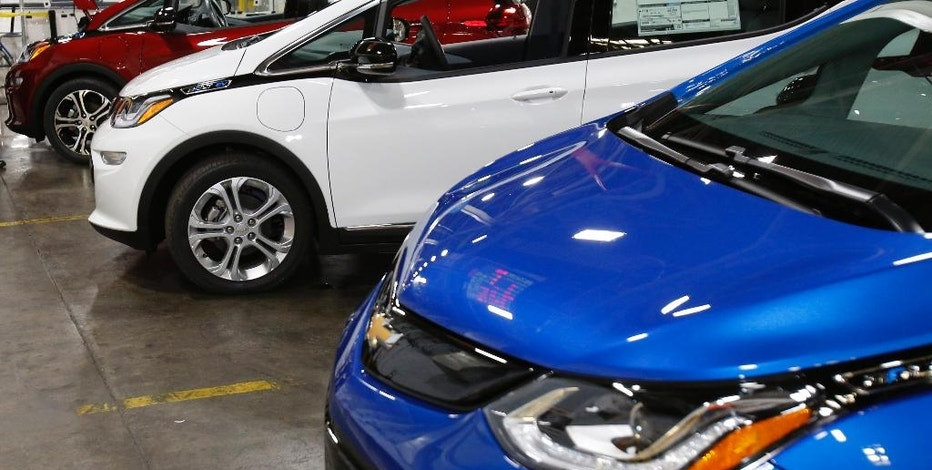 This Nov. 4, 2016, photo shows several Chevrolet Bolt EV vehicles during a tour of the General Motors Orion Assembly plant in Orion Township, Mich. What General Motors wants consumers to see in the Bolt is the electric car that will cater to their everyday needs: commuting, shopping, transporting children and gear, all on one charge of its battery. It's the first electric car to get more than 200 miles per charge and fit most buyers' budgets. (AP Photo/Duane Burleson)