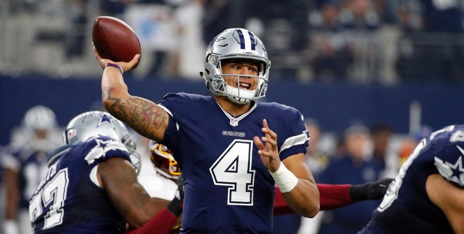 Dallas Cowboys quarterback Dak Prescott (4) throws a pass during the first half of an NFL football game against the Washington Redskins on Thursday, Nov. 24, 2016, in Arlington, Texas. (AP Photo/Michael Ainsworth)