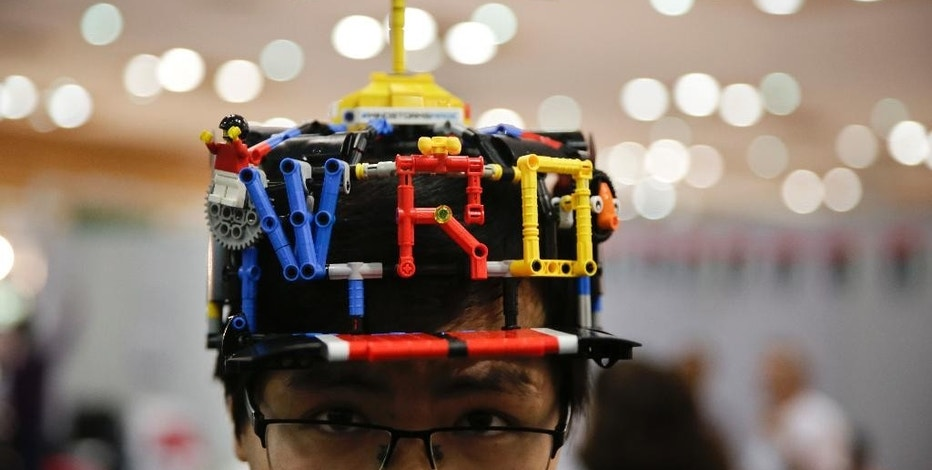 In this Sunday, Nov. 27, 2016 photo, a participant is seen at the World Robot Olympiad in New Delhi, India. The weekend games brought more than 450 teams of students from 50 countries to the Indian capital. The idea is to teach children computer programing at a young age. (AP Photo/Tsering Topgyal)