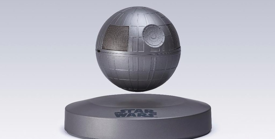 """This photo provided by Plox shows the """"Star Wars"""" Death Star levitating bluetooth speaker. It's a little tricky to set up, but once you get the Death Star positioned correctly over its base, it floats in the air thanks to well-placed magnets and a little help from """"The Force."""" The Death Star rotates with a tap. The sound quality is pretty good, and the rechargeable battery will give you five hours of sound. (Courtesy of Plox via AP)"""