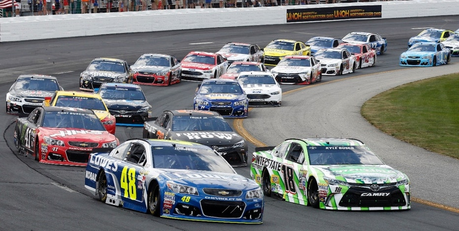 Jimmie Johnson (48) and Kyle Busch (18) lead the pack at the start of the New Hampshire 301 auto race at New Hampshire Motor Speedway, Sunday, July 17, 2016, in Loudon, N.H.