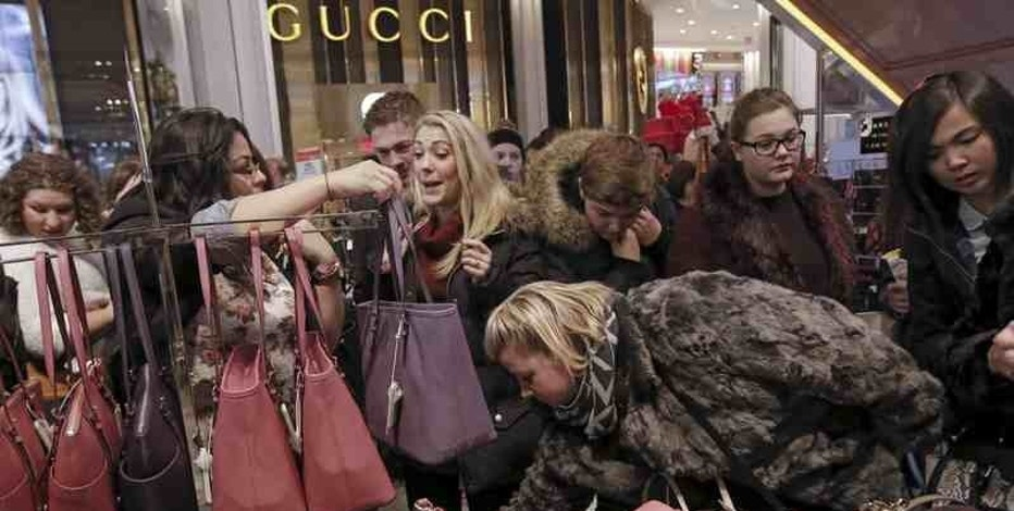 Women shop for handbags at Macy's Herald Square store during the early opening of the Black Friday sales in the Manhattan borough of New York, November 26, 2015. REUTERS/Andrew Kelly/File Photo