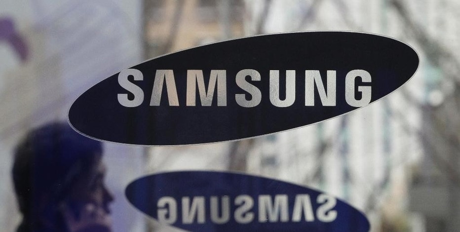 FILE - In this Dec. 12, 2013 file photo, a man passes by the Samsung Electronics Co. logos at its headquarters in Seoul, South Korea. A unanimous Supreme Court on Tuesday, Dec. 6, 2016, sided with smartphone maker Samsung in its high-profile patent dispute with Apple over design of the iPhone. The justices said Samsung may not be required to pay all the profits it earned from 11 phone models because the features at issue are only a tiny part of the devices.  (AP Photo/Ahn Young-joon, File)