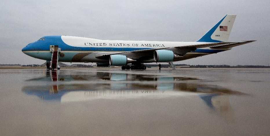 Air Force One is seen on the tarmac at Andrews Air Force Base, Md., Tuesday, Dec. 6, 2016, before President Barack Obama boards en route to MacDill Air Force Base in Tampa, Fla. President-elect Donald Trump wants the government's contract for a new Air Force One canceled. (AP Photo/Carolyn Kaster)
