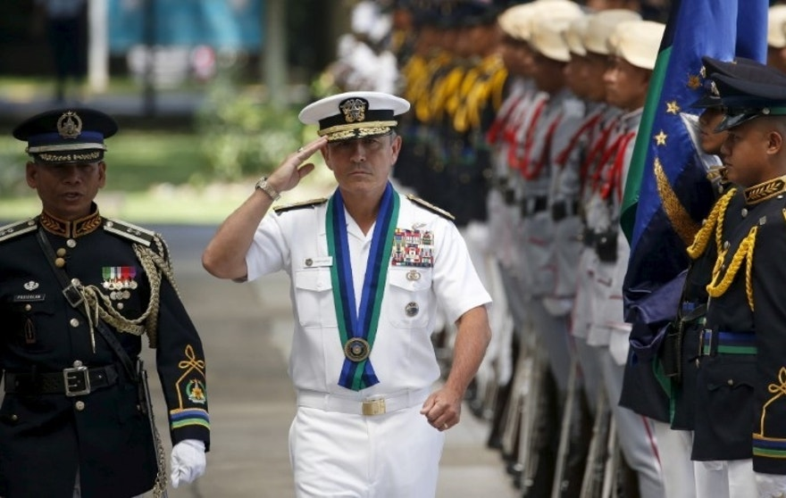 U.S. Navy Admiral Harry Harris, Commander of the U.S. Pacific Fleet, salutes during a welcome ceremony at the Philippine Armed Forces headquarters at Camp Aguinaldo in Quezon City, Metro Manila in the Philippines in this August 26, 2015 file photo. REUTERS/Erik De Castro