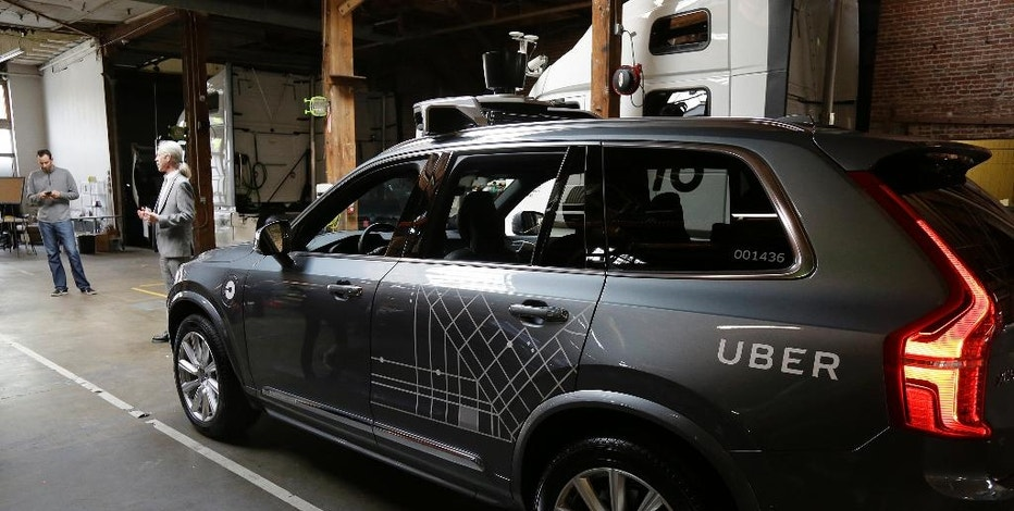In this photo taken Tuesday, Dec. 13, 2016, an Uber driverless car is displayed in a garage in San Francisco. Uber is bringing a small number of self-driving cars to its ride-hailing service in San Francisco - a move likely to both excite the city's tech-savvy population and spark a conflict with California regulators. The Wednesday, Dec. 14, launch in Uber's hometown expands a public pilot program the company started in Pittsburgh in September. (AP Photo/Eric Risberg)