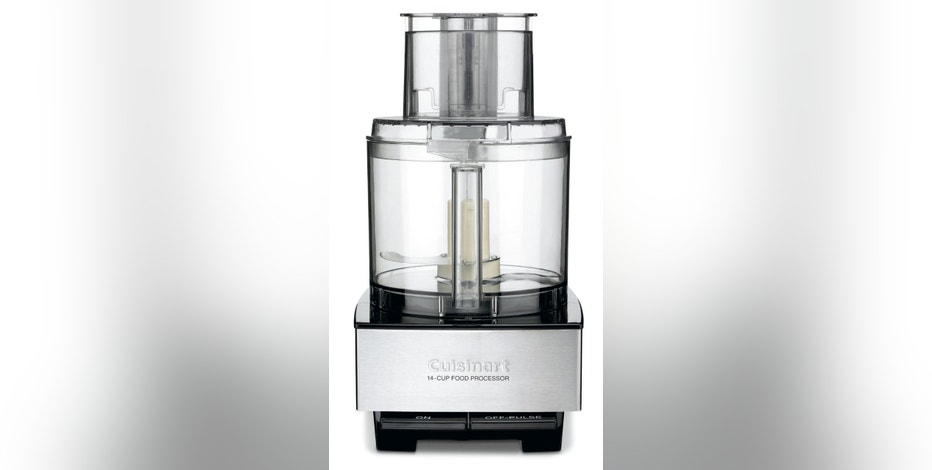 This undated photo provided by Cuisinart shows a Cuisinart 14-cup food processor. Cuisinart is voluntarily recalling about 8 million food processors after dozens of consumers reported finding pieces of broken blades in their food. Cuisinart's parent company, Conair, announced the recall with the Consumer Product Safety Commission on Tuesday, Dec. 13, 2016. The recalled processors were sold in the United States and Canada from July 1996 to December 2015. Only processors with four rivets in the blades are included in the recall. (Cuisinart via AP)