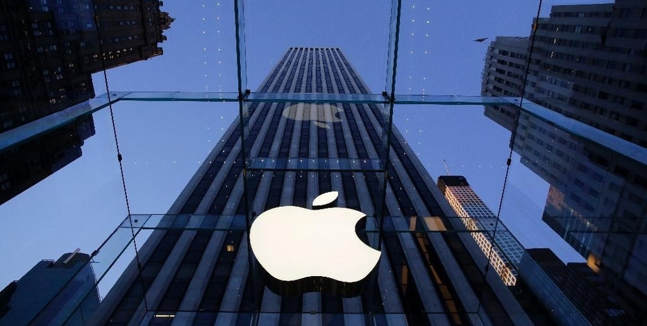 FILE - In this Sept. 5, 2014, file photo, the Apple logo hangs in the glass box entrance to the company's Fifth Avenue store in New York. Ireland is appealing the European Union's landmark order to collect 13 billion euros ($14 billion) in taxes from Apple. (AP Photo/Mark Lennihan, File)