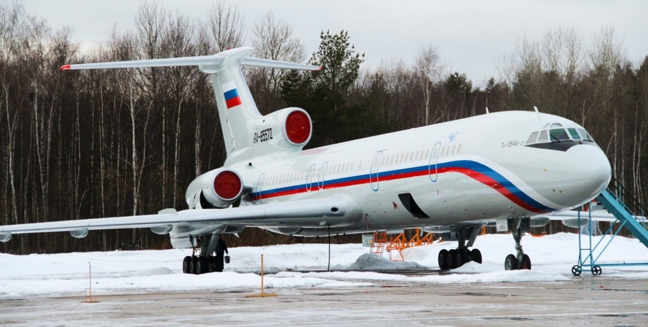 This photo taken on Thursday, Jan. 15, 2015 shows the Tu-154 plane with registration number RA-85572 at Chkalovsky military airport near Moscow, Russia. A Russian plane with 92 people aboard, including a well-known military band, crashed into the Black Sea on its way to Syria on Sunday, Dec. 25, 2016, minutes after takeoff from the resort city of Sochi, the Defense Ministry said. The Tu-154, the same plane shown in this photo, which belonged to the Defense Ministry, was taking the Alexandrov Ensemble to a concert at the Russian air base in Syria. (AP Photo/Dmitry Petrochenko)