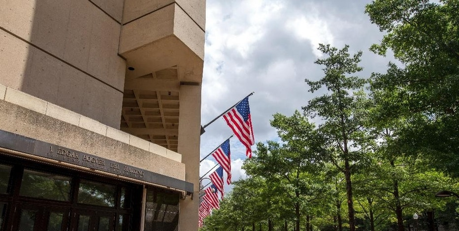 In this photo taken Aug. 19, 2015, the J. Edgar Hoover Building, The Federal Bureau of Investigation headquarters in Washington. The U.S. has released its most detailed report yet on accusations that Russia interfered in the U.S. presidential election by hacking American political sites and email accounts. The 13-page joint analysis by the Department of Homeland Security and the FBI is the first such report ever to attribute malicious cyber activity to a particular country or actors.  (AP Photo/Andrew Harnik)