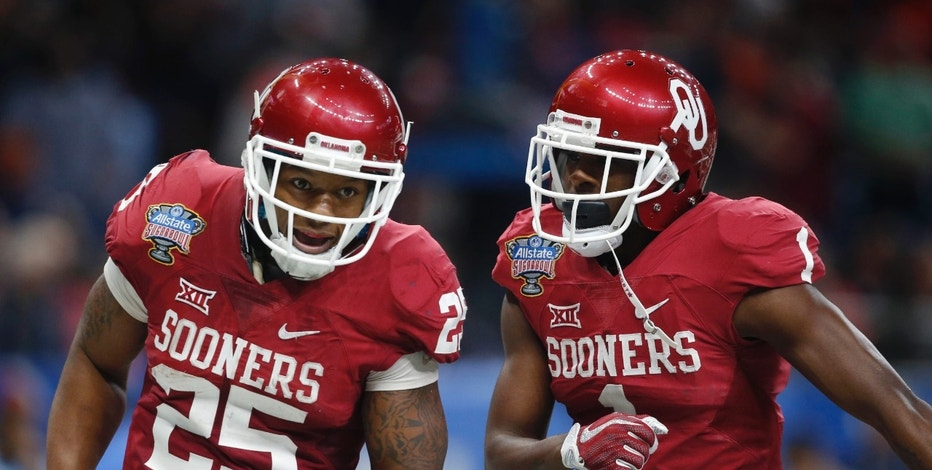 Oklahoma running back Joe Mixon (25) celebrates his touchdown with wide receiver Jarvis Baxter (1) in the first half of the Sugar Bowl NCAA college football game in New Orleans, Monday, Jan. 2, 2017. (AP Photo/Gerald Herbert)