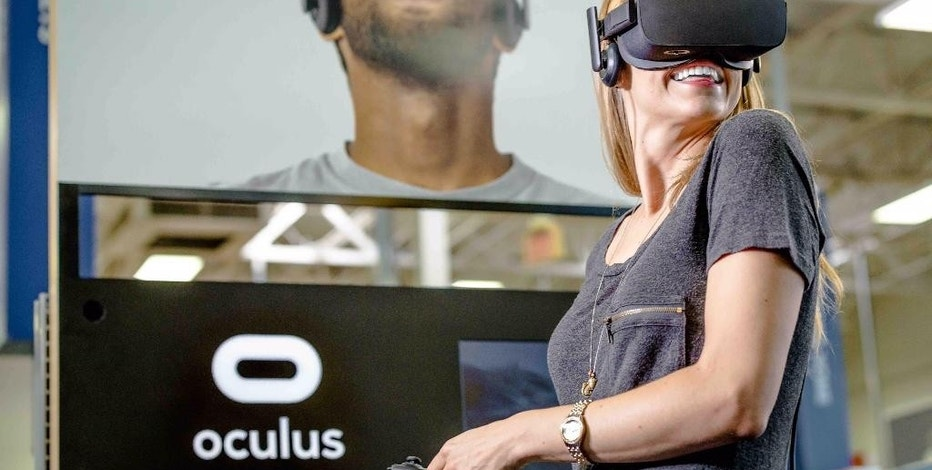 This photo provided by Best Buy shows an example of Best Buy's demonstration for Facebook Inc.'s Oculus Rift headsets. From robots to interactive mirrors to shelves embedded with sensors, tomorrow's retail stores will embrace technologies to not only draw shoppers back from e-commerce but also nudge them to spend more. (Courtesy of Best Buy via AP)