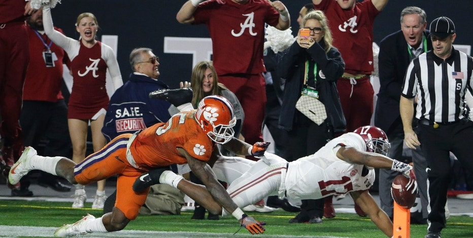 FILE - In a Jan. 11, 2016 file photo, Alabama's Kenyan Drake gets past Clemson's T.J. Green as he runs back a kick off for a touchdown during the second half of the NCAA college football playoff championship game in Glendale, Ariz. A year ago, Alabama beat Clemson 45-40 in a thriller. This is the first time in the college football title-game era that same two teams got to the season's final matchup. Alabama and Clemson play in Tampa, Fla. on Monday night.  (AP Photo/David J. Phillip, File)