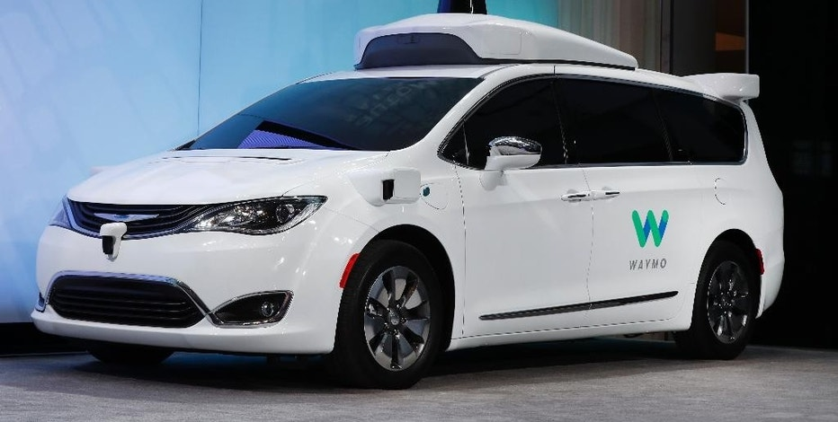 A Chrysler Pacifica hybrid outfitted with Waymo's suite of sensors and radar is shown at the North American International Auto Show in Detroit, Sunday, Jan. 8, 2017. Waymo is the autonomous vehicle company created by Google's parent company, Alphabet. (AP Photo/Paul Sancya)